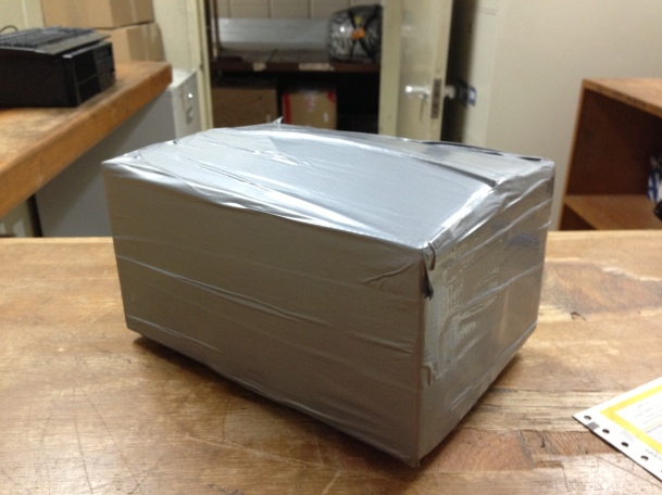 Number 3,285th use of duct tape-Doha's way of covering up a box for shipping